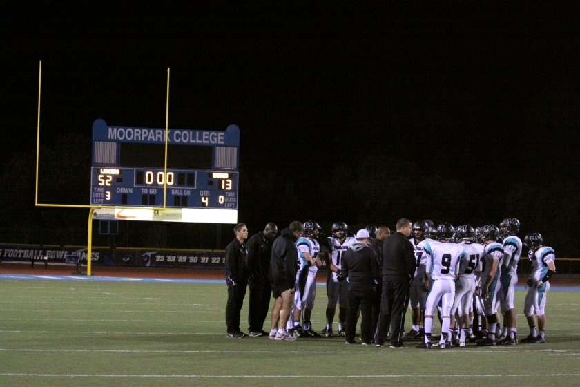 Malibu High in a huddle after losing 52-13 to Grace Brethren on Nov. 8.